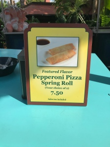 Pepperoni Pizza Spring Rolls sign at cart nearby Pirates of the Carbibbean ride in Magic Kingdom