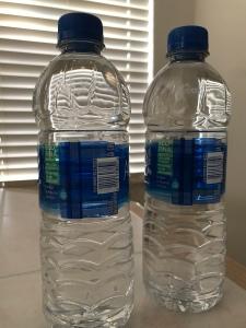 Two full spring water bottles