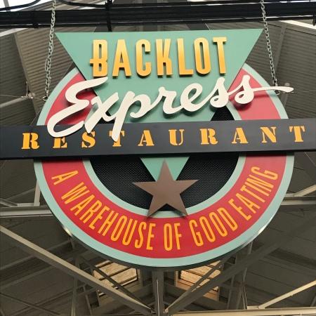 Large hanging sign for Backlot Express Restaurant