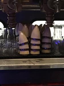 Beer flight size cups that look like Rancor teeth from Star Wars