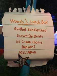 Sign for Woody's Lunchbox that looks handwritten on piece of scrap paper