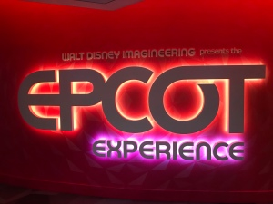 Neon Lit Epcot Experience Sign at Theater in Odyssey
