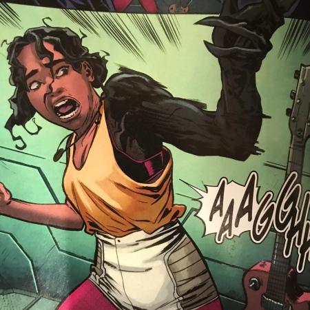 Venom 2099 comic image of Alea with symbiote arm